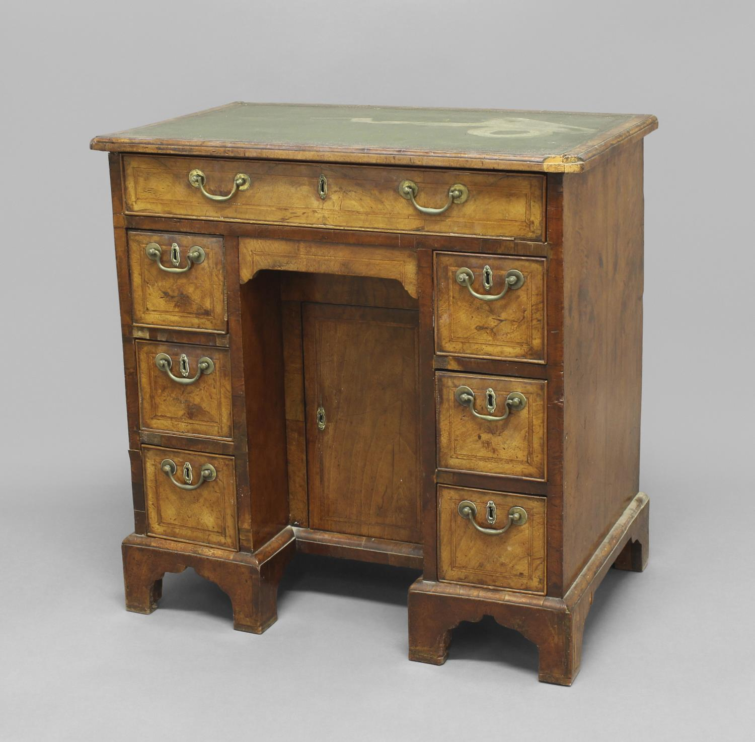 A GEORGE II WALNUT KNEEHOLE DESK, the leather top above one long drawer and an arrangement of six - Image 2 of 2