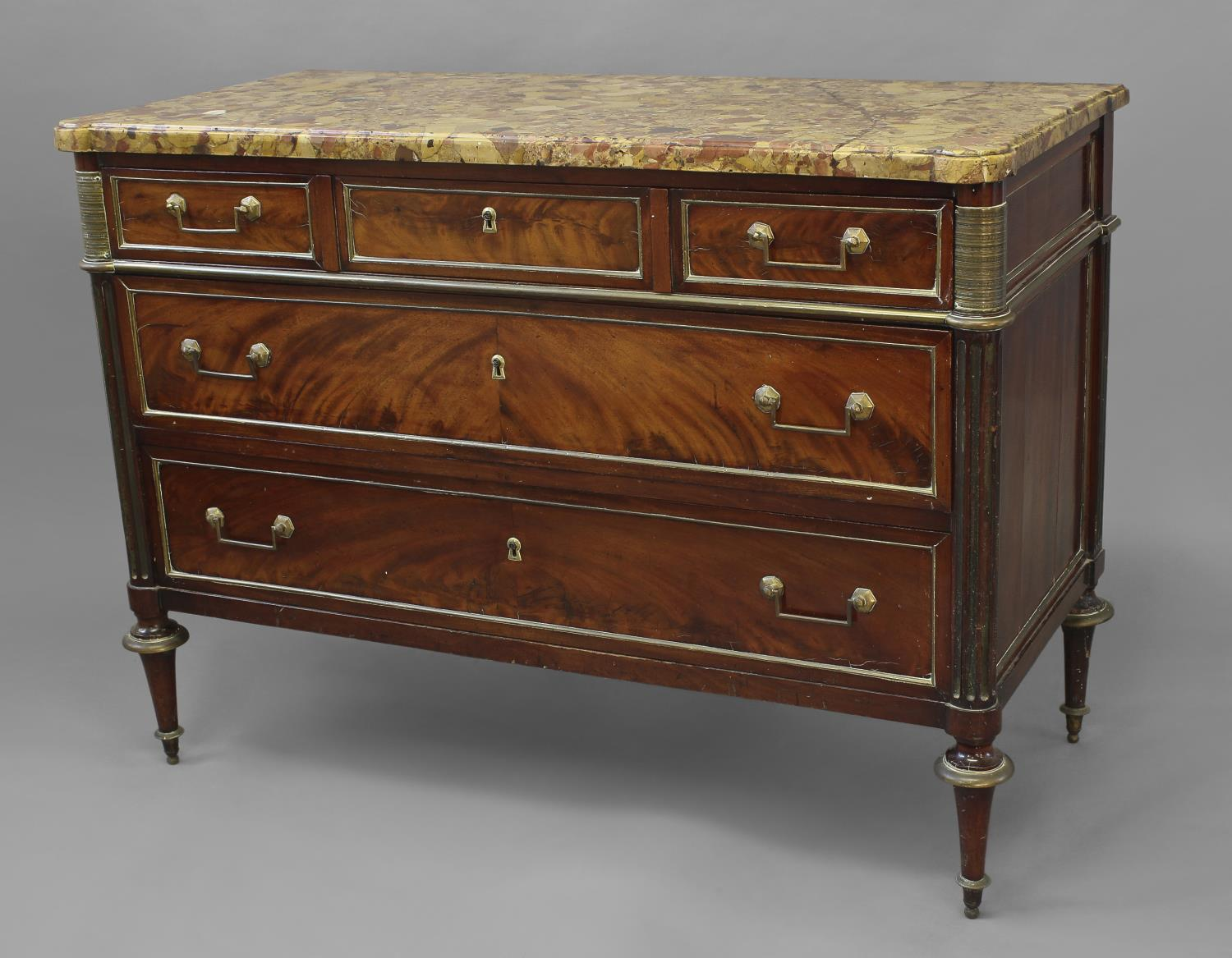 A LOUIS XVI MAHOGANY AND BRASS MOUNTED CHEST OF DRAWERS, with a fine variegated marble top with