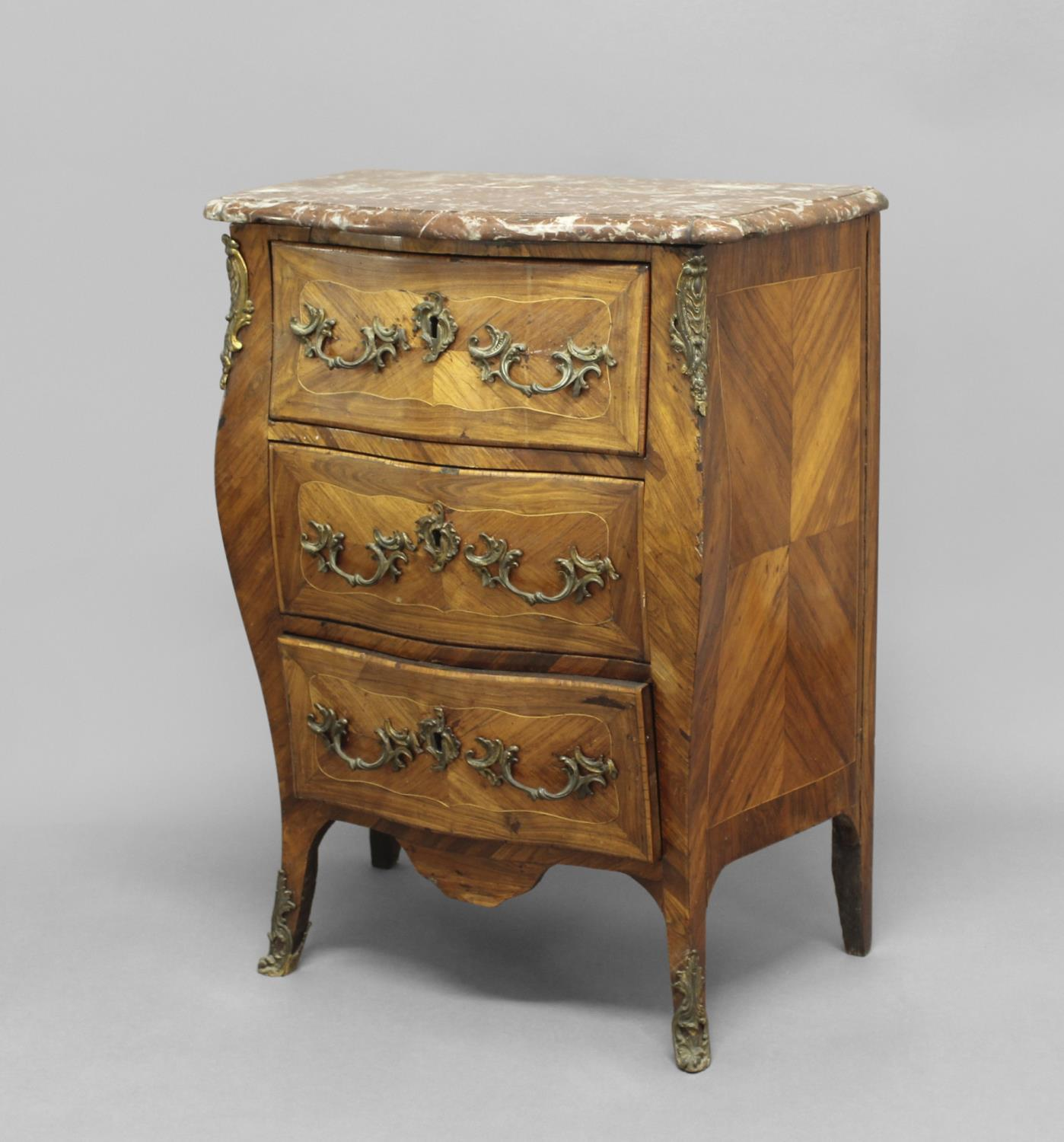 A LOUIS XV STYLE BOMBÉ MARBLE-TOPPED COMMODE, the pink marble top above three drawers with scrolling - Image 2 of 2