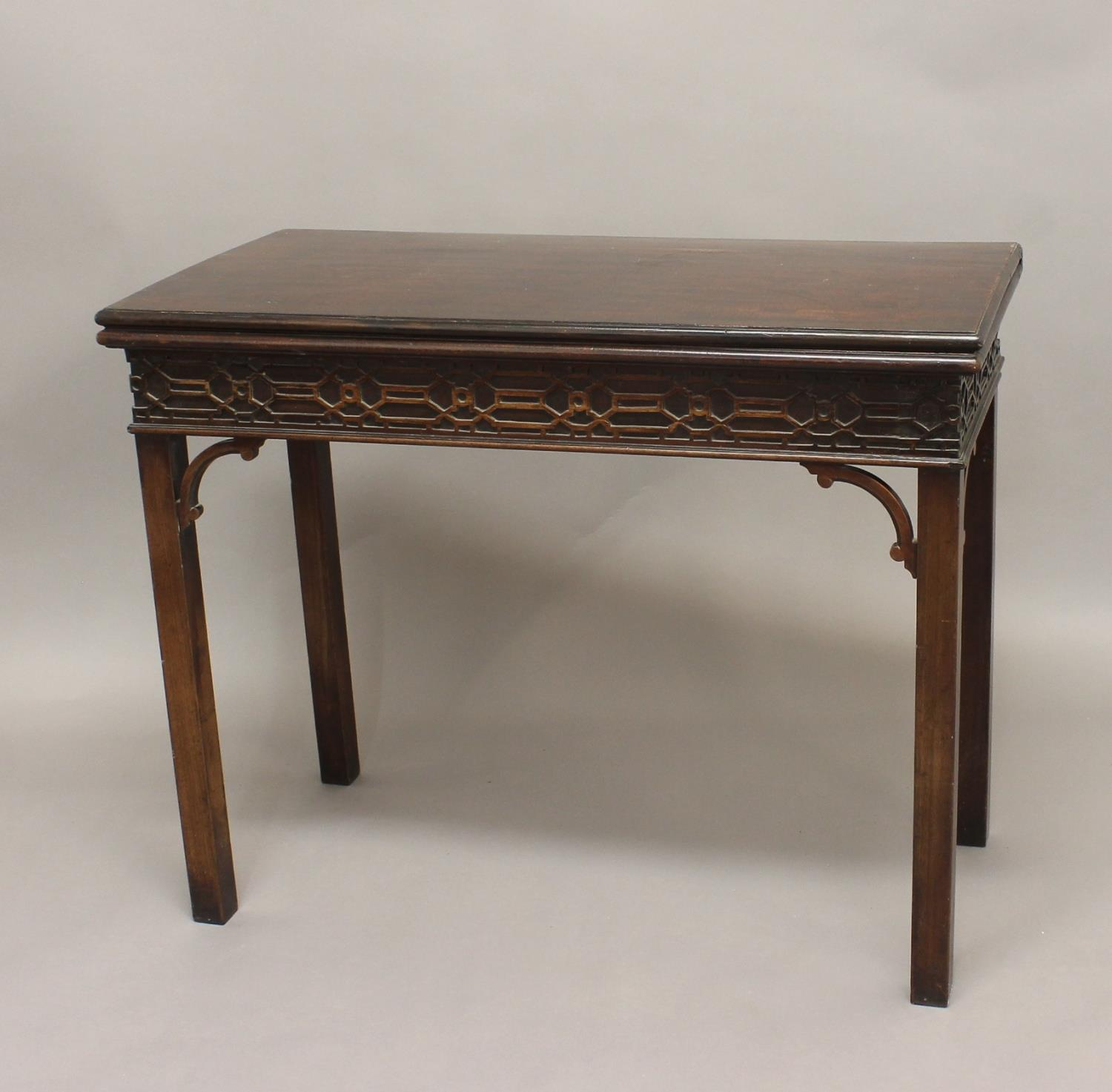 A GEORGE III MAHOGANY CARD TABLE. With a rectangular fold top with moulded border and baize lined