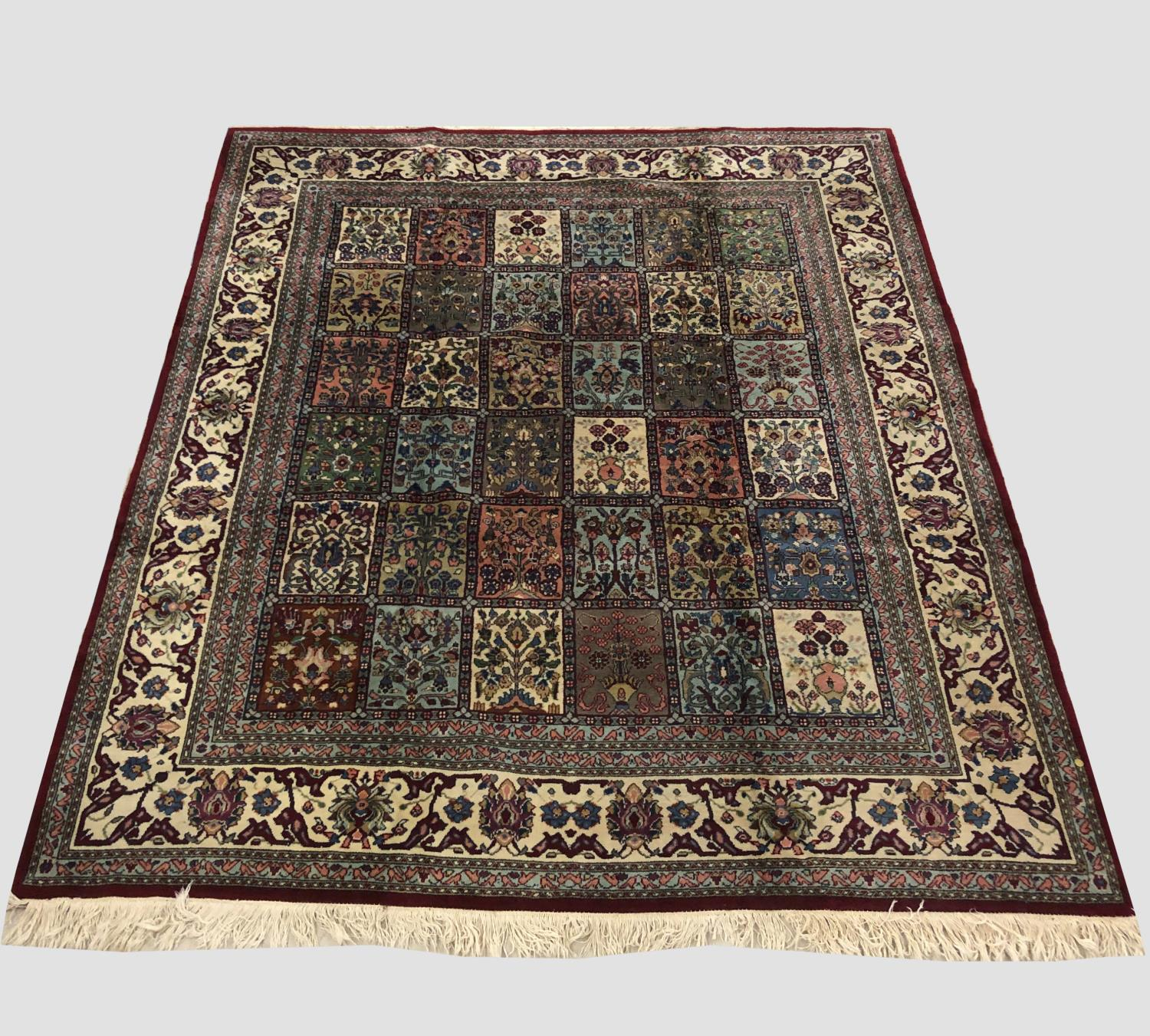 AN INDIAN CARPET, the compartmentalised field of polychrome flowering plants enclosed by ivory