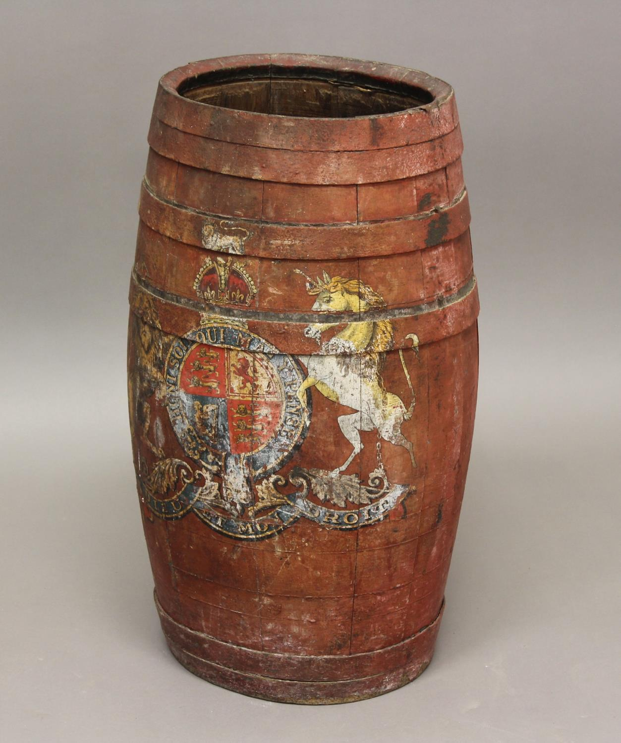 A RED PAINTED BARREL WITH ROYAL COAT OF ARMS. A red painted coopered barrel of oval bellied form