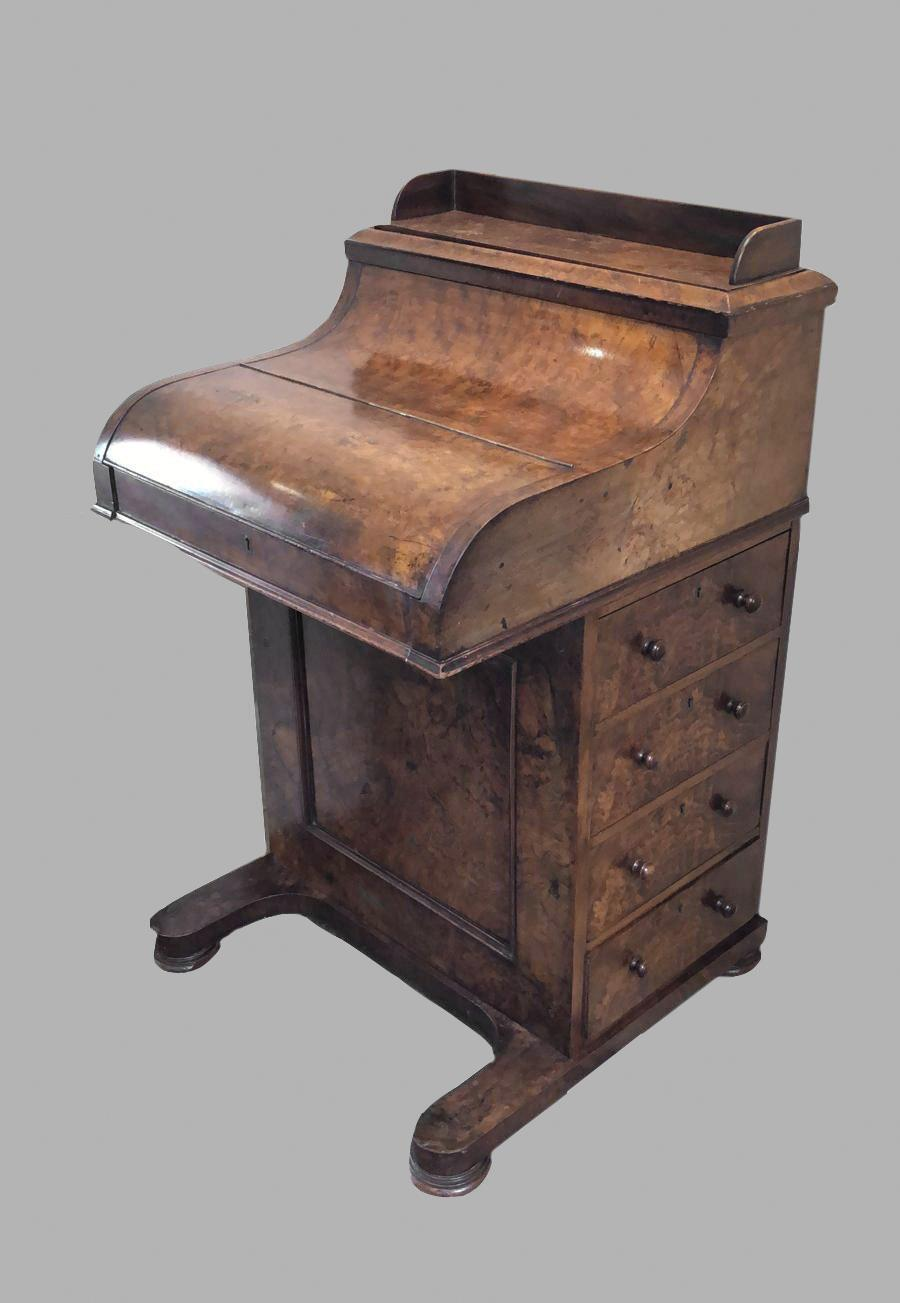 A VICTORIAN BURR WALNUT PIANO FRONTED DAVENPORT. The sliding writing surface releasing a pop-up
