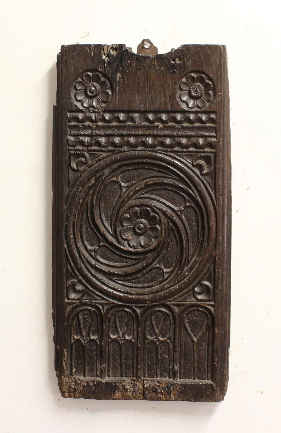 A 16TH CENTURY PEW END SECTION. A rectangular section from a 16th century or earlier pew end, carved