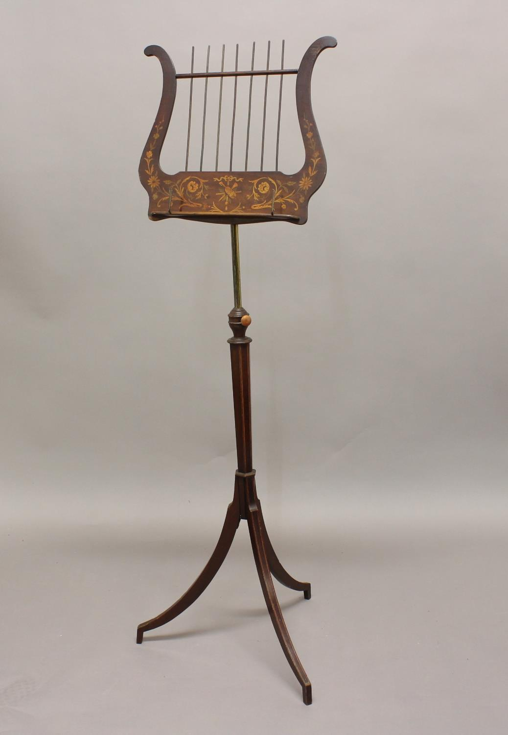 AN EDWARDIAN INLAID MAHOGANY ADJUSTABLE MUSIC STAND. The lyre shaped music support inlaid with