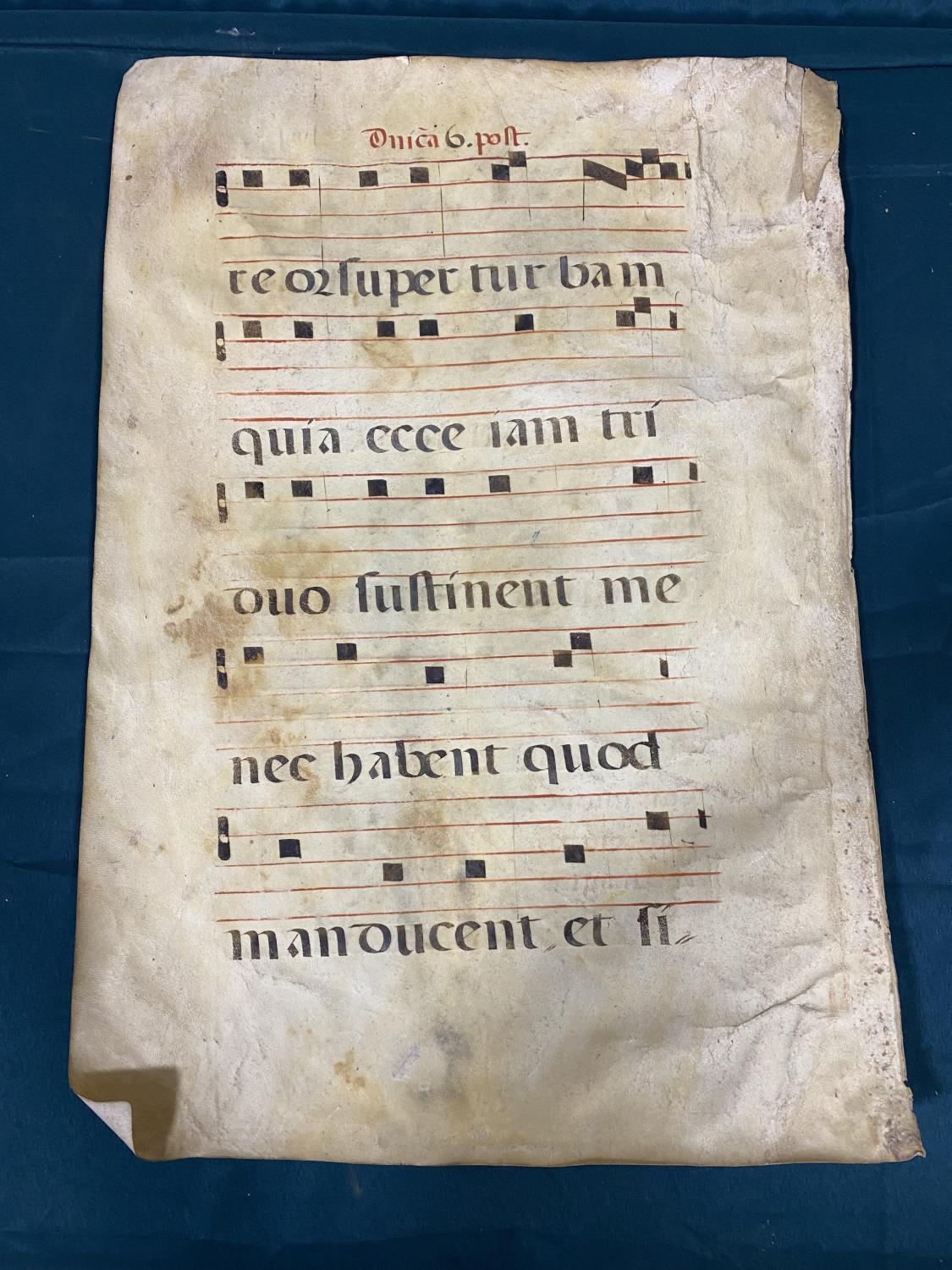 Early Music. A single manuscript leaf of music, on vellum, recto verso, decorated initial with