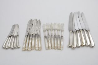 A SET OF SIX LATE VICTORIAN ENGRAVED FISH KNIVES AND FORKS with carved mother of pearl handles,