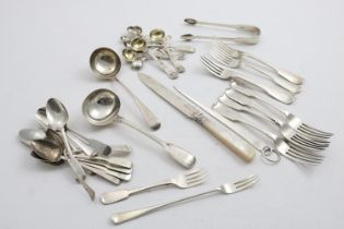 A MIXED LOT:- A set of four Fiddle pattern dessert forks by William Eaton, London 1839, four other