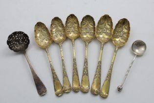 SIX LATER-DECORATED ANTIQUE TABLE SPOONS with chasing and parcel-gilding (for use as fruit serving