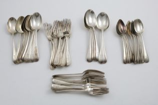 A GEORGE V PART-SERVICE OF OLD ENGLISH PATTERN FLATWARE:- Twelve table spoons, six slightly larger