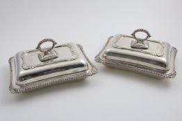 A PAIR OF EDWARDIAN CUSHION-SHAPED ENTREE DISHES & COVERS rectangular with gadrooned borders,