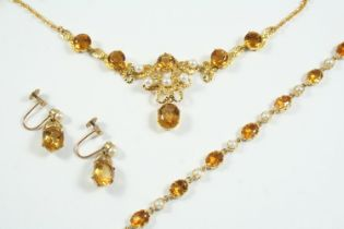 A CITRINE AND CULTURED PEARL NECKLACE mounted with circular-cut citrines and cultured pearls, in 9ct