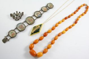ASSORTED JEWELLERY including a graduated oval-shaped amber bead necklace, 54cm long, 31 grams, a