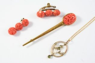 A CORAL AND GOLD BROOCH mounted with an oval section of foliate carved coral in 9ct gold, 9cm