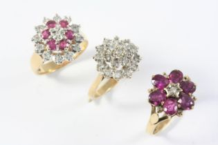 A RUBY AND DIAMOND CLUSTER RING mounted with circular-cut rubies and diamonds in gold, size M,