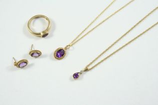 AN AMETHYST AND DIAMOND PENDANT the pear-shaped amethyst is set with a circular-cut diamond in gold,