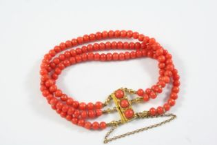 A THREE ROW UNIFORM CORAL BEAD BRACELET the coral beads are set to a gold rectangular-shaped
