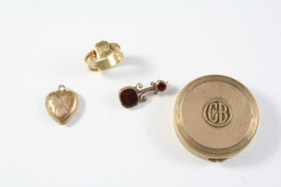 A GEORGIAN GARNET AND GOLD BROOCH mounted with two foil backed garnets in gold closed back