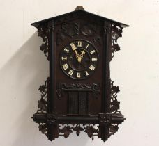 A LATE 19TH CENTURY AUSTRIAN BLACK FOREST 'TRUMPETER' WALL CLOCK. the oak case carved with leaves