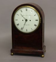 A REGENCY MAHOGANY BRACKET CLOCK BY DWERRIHOUSE AND CARTER. With a circular convex dial with Roman