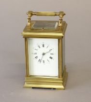 A LATE 19th CENTURY BRASS CASED CARRIAGE CLOCK. With a rectangular white enamelled dial with Roman