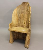 A PRIMITIVE 'DUG OUT' TYPE CHAIR. An unusual 'dug out tree trunk' type chair with solid seat,