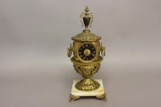 AN ELABORATE URN SHAPED MANTEL CLOCK. The clock with a black dial with gilt Roman numerals, with