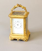 A GILT BRASS CASED CARRIAGE CLOCK BY BOLVILLER OF PARIS. With a rectangular white enamelled dial
