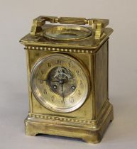 A VICTORIAN BRASS CASED MANTEL CLOCK AND BAROMETER. With a circular dial with recessed centre with