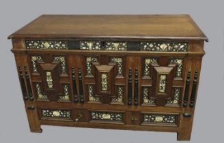 A 17TH CENTURY BONE AND EBONY INLAID COFFER. With a rectangular rising top with moulded border,