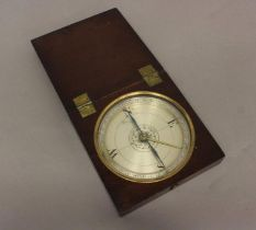 A TRAVELLING COMPASS BY DOLLOND OF LONDON. With a 12cm silvered dial, with a central flower