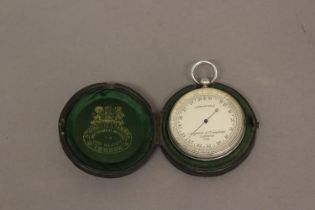 A POCKET BAROMETER BY NEGRETTI AND ZAMBRA. An aneroid pocket barometer with a 4.5cm silvered dial