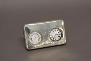 A BAROMETER AND WATCH SILVER FRONTED DESK SET. The rectangular silver fronted case with rounded