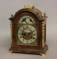 A GEORGE II STYLE WALNUT CASED BRACKET CLOCK. The arched dial with moon phase above a silvered