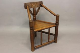 A 17TH CENTURY STYLE TURNERS CHAIR. With a chip carved horizontal top rail with geometric