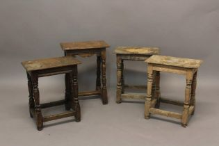 A COLLECTION OF FOUR 17TH CENTURY STYLE JOINT STOOLS. Each with rectangular seats with moulded