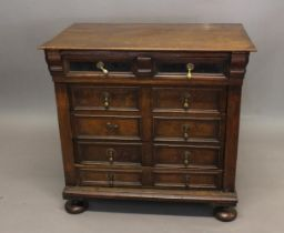 A LATE 17TH CENTURY OAK CHEST OF DRAWERS. With a rectangular top above a single long projecting