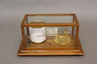 A BAROGRAPH/STORMOGRAPH BY SHORT AND MASON OF LONDON. A gilt metal barograph, the mechanism