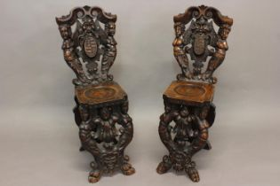 A NEAR PAIR OF VENETIAN STYLE SCABELLO HALL CHAIRS. Each with elaborate scrolling backs with a