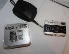 1 Kamera Rollei 35 T, sowie der dazugehörige Blitz Rollei 128 BC1 Rollei 35 T camera and the corre