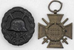 Zwei Orden 1. WK: Frontkämpferabzeichen und Verwundetenabzeichen, schwarz.Two medals WWI: front co