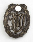 Reichs - Sportabzeichen, bronze, 2. WK. Innen: Ferd. Wagner, D.R.G.M. 35269.Reich sports badge, br