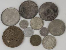 Lot Münzen und Medaillen aus aller Welt.
