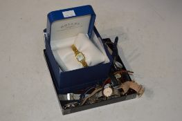 YELLOW METAL LADIES ROTARY WRIST WATCH WITH MOTHER OF PEARL DIAL AND ROMAN NUMERAL DETAIL IN