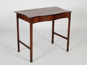 A 19th century mahogany serpentine side table in George III style, the shaped top above a single