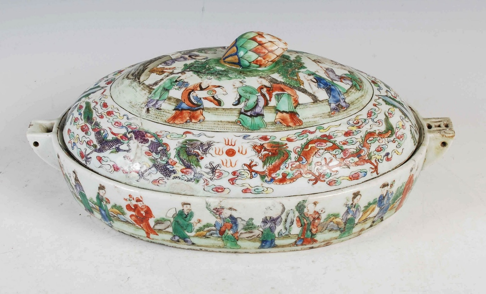 A Chinese porcelain famille rose covered warming tureen, Qing Dynasty, the oval shaped base