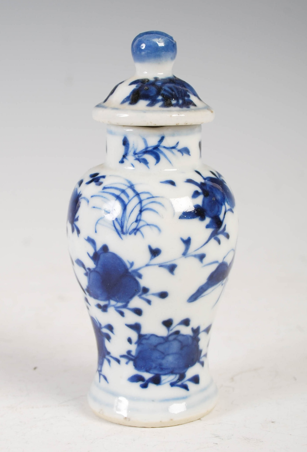 A miniature Chinese blue and white porcelain jar and cover, late Qing Dynasty, decorated with - Image 2 of 4