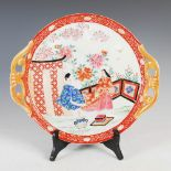 A Japanese Imari twin handled circular tray, late 19th/ early 20th century, decorated with fenced