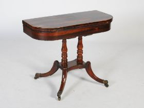 An early 19th century rosewood, boxwood lined and gilt metal pedestal games table, the hinged D-