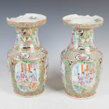 A pair of Chinese porcelain famille rose Canton vases, Qing Dynasty, decorated with oval shaped